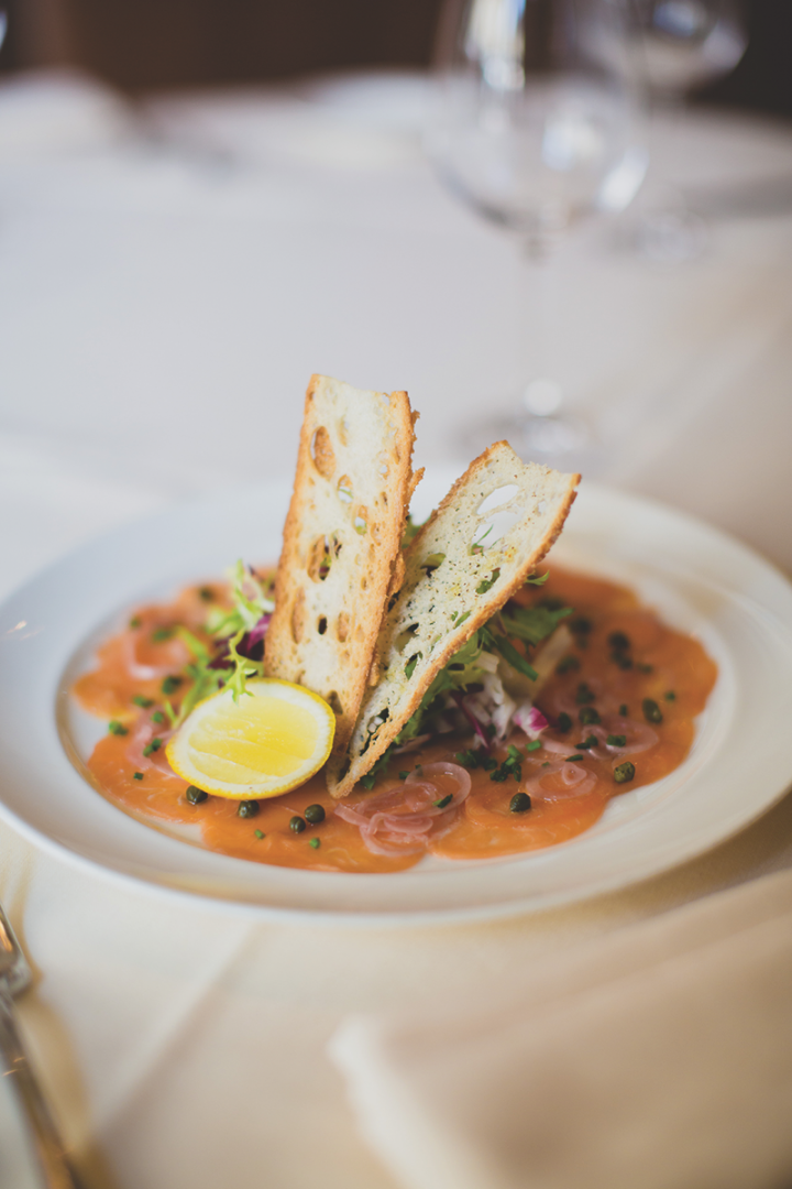 In addition to owning Quattro Gastronomia (restaurant's salmon carpaccio pictured), KNR manages several on-premise venues within the W South Beach.