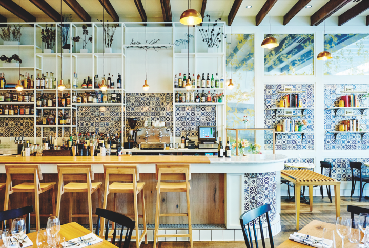Sardella, Niche's newest restaurant, features a seasonal, globally influenced Italian menu. An Italy-focused wine list, plentiful craft beer offerings and a number of specialty cocktails round out the drinks program (bar counter pictured).