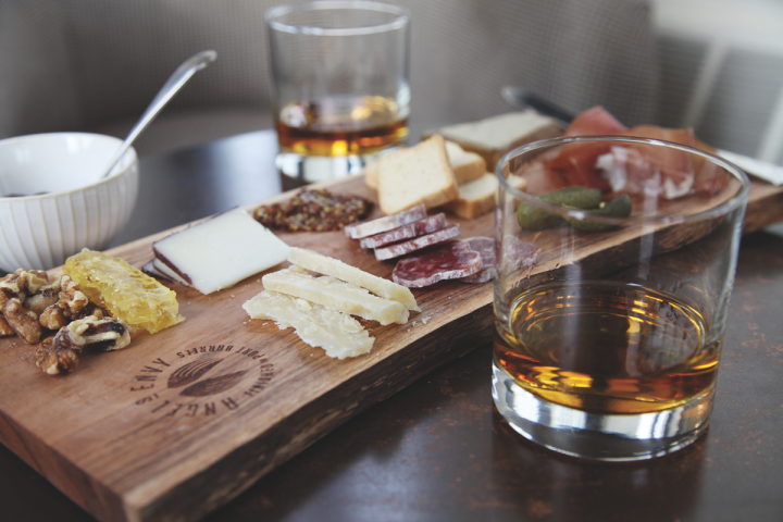 Bourbons like Angel's Envy pair well with many meats (Angel's Envy with charcuterie pictured).