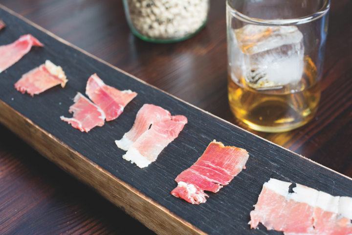 The fatty, cured meats at Husk in Charleston, South Carolina (country ham pictured) pair nicely with barrel-strength Bourbon whiskies like Willet 12-year-old.