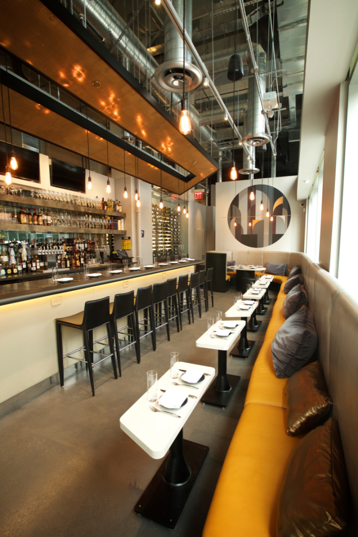The new Wine Legend—The Bar & The Store (bar pictured) in Brooklyn features craft cocktails, draft beer and wine on tap alongside small plates. The bar is adjacent to the company's retail component.