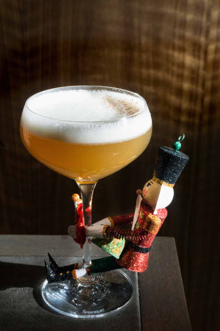 The NoMad Holiday Spectacular's Nut King Cole features Guyanese and Guatemalan rums, Amontillado Sherry, roasted chestnuts, Nocino, lemon and egg whites, as well as an attached nutcracker figurine.