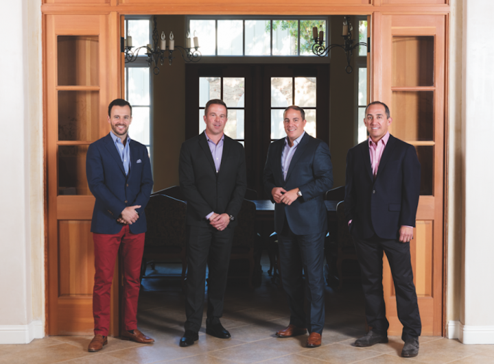 The Wilson Daniels executive team includes (from left to right) vice president of private client group services Mike Hoagland, senior vice president of sales and marketing Bob Guinn, president Rocco Lombardo, and vice president of marketing and brand management Scott Diaz.