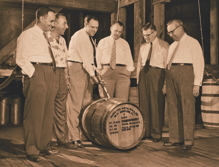 The Shapira brothers, cofounders of Heaven Hill Distillery, fill Bourbon barrel number 500,000 on September 30th, 1955. From left: Ed Shapira, vice president and general manager Charlie DeSpain, David Shapira, Mose Shapira, George Shapira and Gary Shapira.