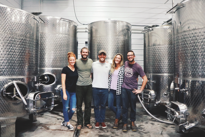 Old Westminster Winery (estate director Ashli Johnson, winemaking assistant Ian Mansfield, co-owner Drew Baker, head winemaker Lisa Hinton, and winemaking assistant Joey Fox pictured) started canning its natural, high-end wines last year.