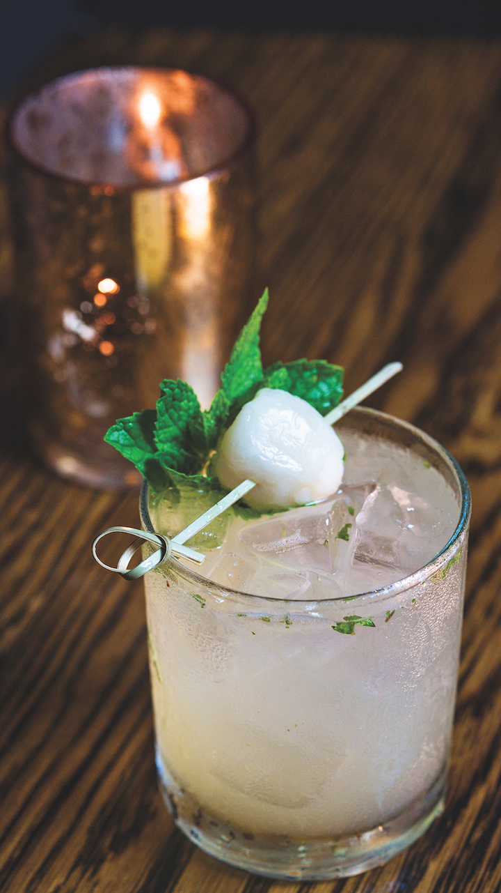 Sushi Roku's Ginger Lychee Mojito mixes Cruzan Aged Light rum, lime juice, and a house-made syrup that blends fresh mint, lychee fruit, and ginger. The drink is topped with a float of Pyrat XO rum.