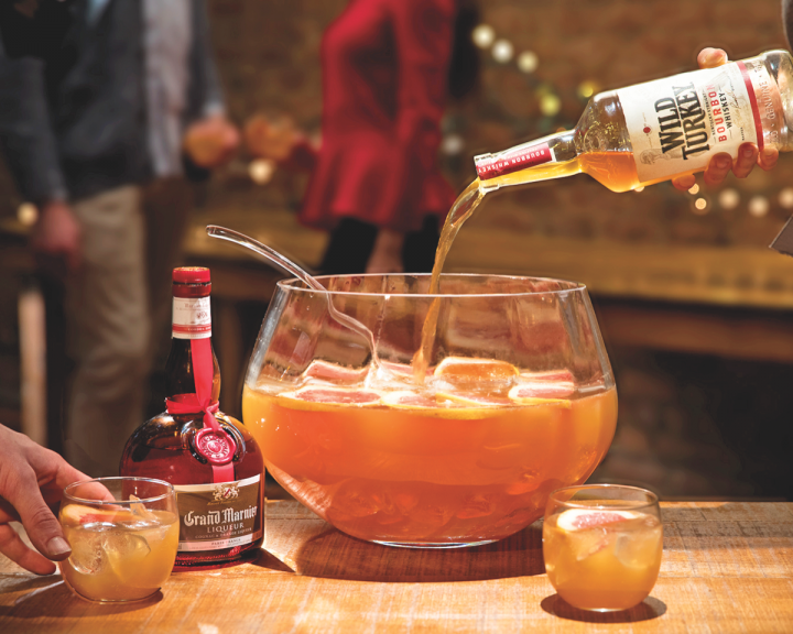 Grand Marnier's spiced orange and Cognac core make it an excellent addition to brown spirits-based wintertime cocktails. The Derby Hat Punch blends Grand Marnier with Wild Turkey Bourbon, honey syrup, Brut Champagne, and grated nutmeg.