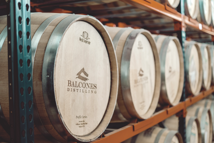 Known for its innovative spirit, Balcones is currently working on a variety of new expressions, including whiskies finished in Tequila, Port, and Sherry casks (barrel rack pictured).