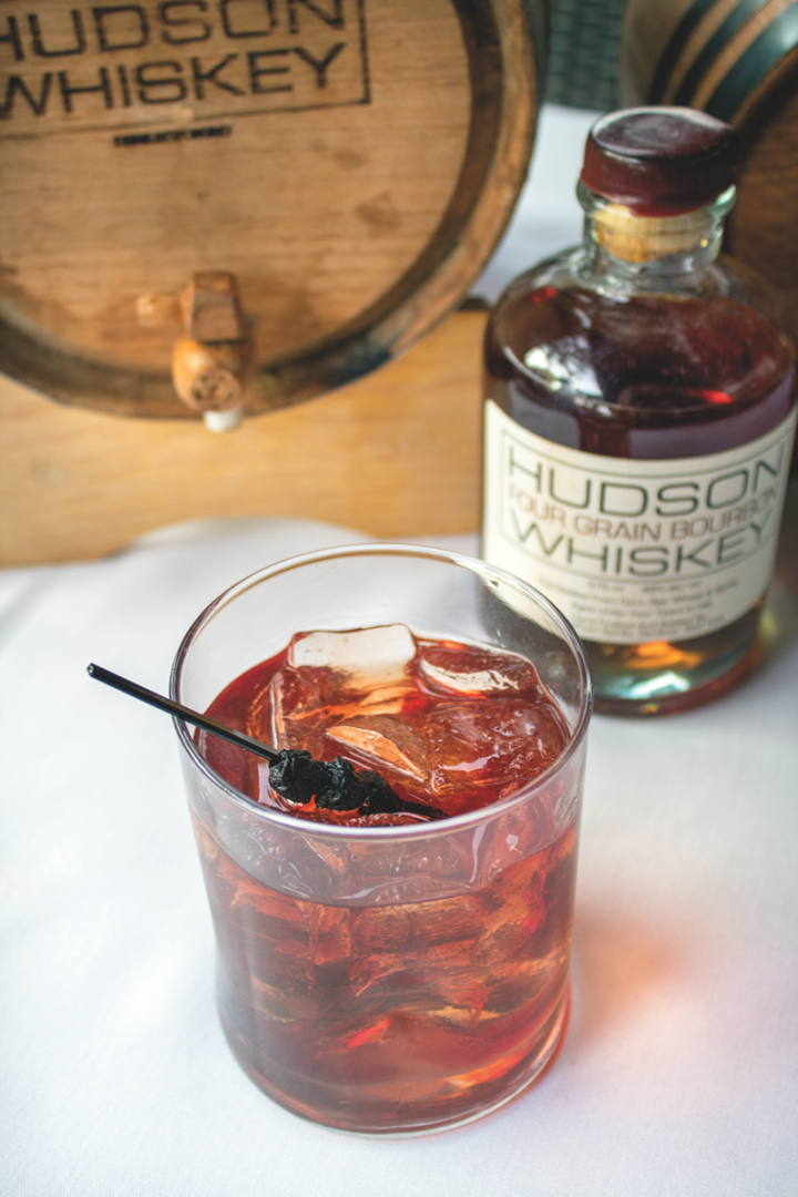 At Cohn Restaurant Group's Bluepoint Coastal Cuisine, The New Yorker is a twist on the Manhattan, mixing a house-aged blend of Hudson's Baby Bourbon, Manhattan Rye, and New York Corn whiskies with Dolin Rouge vermouth and house-made blueberry bitters.