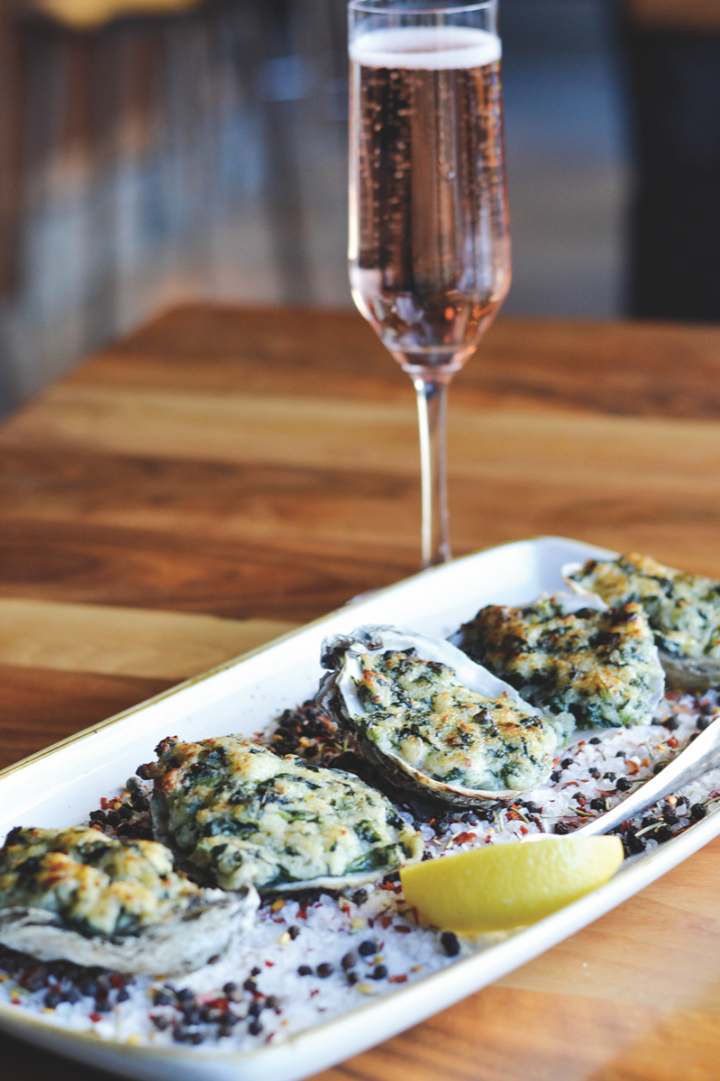 At modern American venue Remington's, seafood (oyster dish pictured) and steak are the main attractions.
