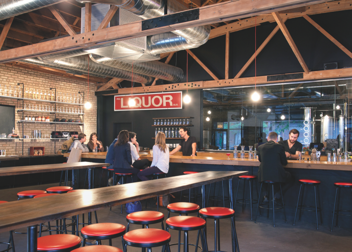 Multiple Chicago area distillers are looking to expand their distribution. Chicago Distilling Co. (lounge pictured) plans to add five more states to its current four-state portfolio this year.