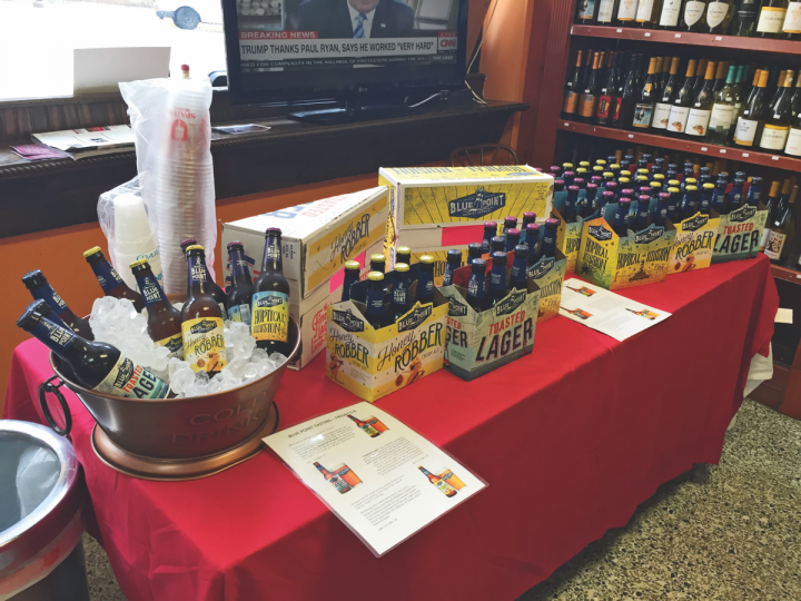 ExperTaste Marketing (Blue Point Brewery sampling table pictured) arranges in-store sampling events for brewers and provides them with detailed data on consumer buying habits as well.
