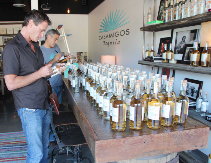 Lately, the Tequila category has been defined by its acquisitions, with Diageo purchasing Casamigos Tequila from entrepreneur Rande Gerber and actor George Clooney (pictured signing bottles) for up to $1 billion.