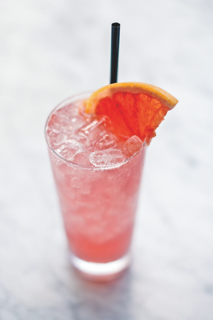 Miami's Upland offers a Hibiscus Collins, which features Tito's vodka, Cocchi Americano aperitif, house-made hibiscus syrup, and lemon and grapefruit juices.