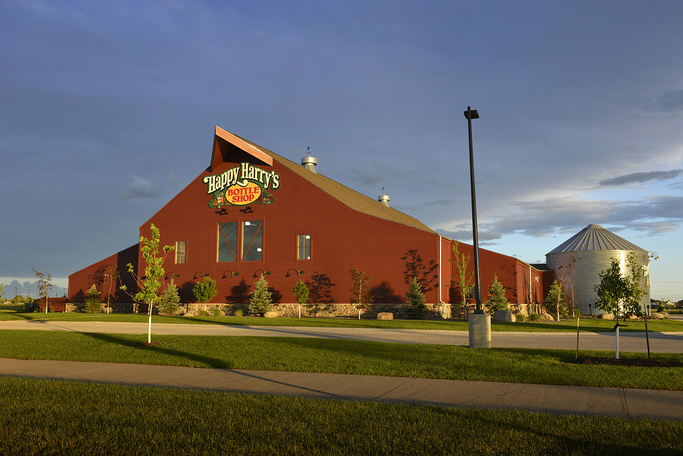The latest Happy Harry's Bottle Shop on the south side of Fargo (exterior pictured) features a parking lot with plug-ins for electric cars and 100 trees planted in the surrounding outdoor space. Inside, energy-saving LED lights brighten displays.