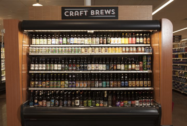 Imported and craft beer (cooler above) is gaining ground at Raley's, where top-sellers include Lagunitas IPA and Denmark's Munkebo Viking King porter.