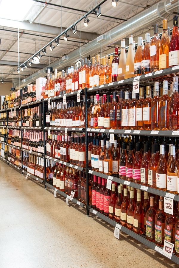Twin Liquors takes special care to promote local products. Earlier this year, the store hosted an event where Texas rosés were tasted alongside worldwide rosés (rosé shelf above).