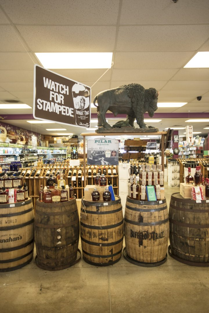 Among Wine World's 1,100 spirits SKUs (Bourbon display above) include the store's exclusive barrel selections.