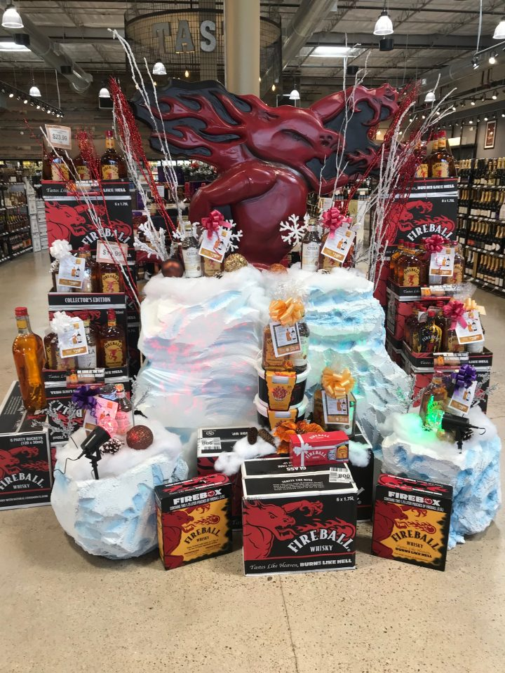 Twin Liquors showcases a prominent display of Fireball gift sets (pictured above) for the holiday season.