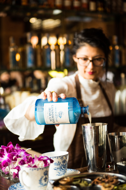 In the U.S., gin is seeing the most action at upscale bar and restaurant accounts, where mixologists have enthusiastically embraced the spirit as a high-end cocktail ingredient (Liquid Productions' Lulu Martinez pictured above, mixing a Drumshanbo-based cocktail).