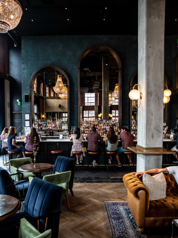 New York City-based Death & Co. expanded for the first time last year, opening an airy location in Denver's The Ramble Hotel (main lobby bar pictured).