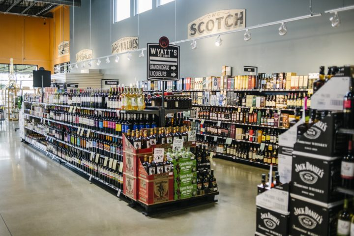 Colorado craft whiskey is a strong and growing category at Wyatt's Wet Goods (spirits shelves pictured). Dinsmore says Colorado spirits overall are popular with customers. (Photo by Matt Nager)