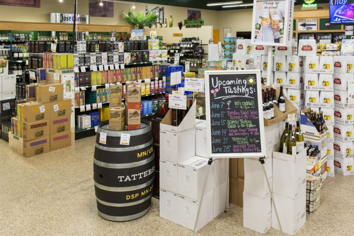 Haskell's puts major emphasis on tastings (signage and display pictured), hosting as many as 25 wine, spirits, and beer events each week across all 11 Haskell's locations.