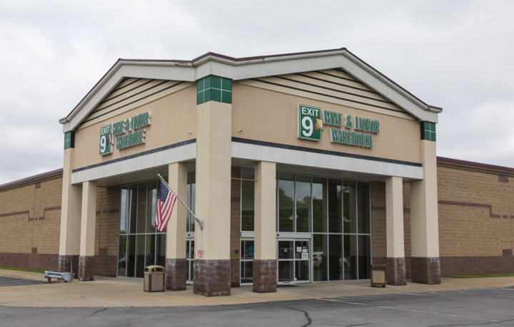 """Mark O'Callaghan's  rst tagline for Exit 9 Wine & Liquor Warehouse (exterior pictured) was """"It's fine at Exit 9."""" He's worked to market the business beyond just wine and spirits, drawing in new customers with good service, competitive prices, and a wide product selection."""