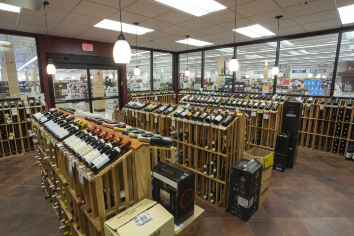 Exit 9 (wine room pictured) offers approximately 4,800 wine SKUs, and customers can try wine samples seven days a week at the Wine Attic tasting station.