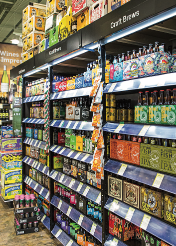 Total Wine & More (craft beer shelves pictured) has a smartphone app boasting label-recognition capabilities that includes wayfinding technology to help shoppers locate specific products in the store.