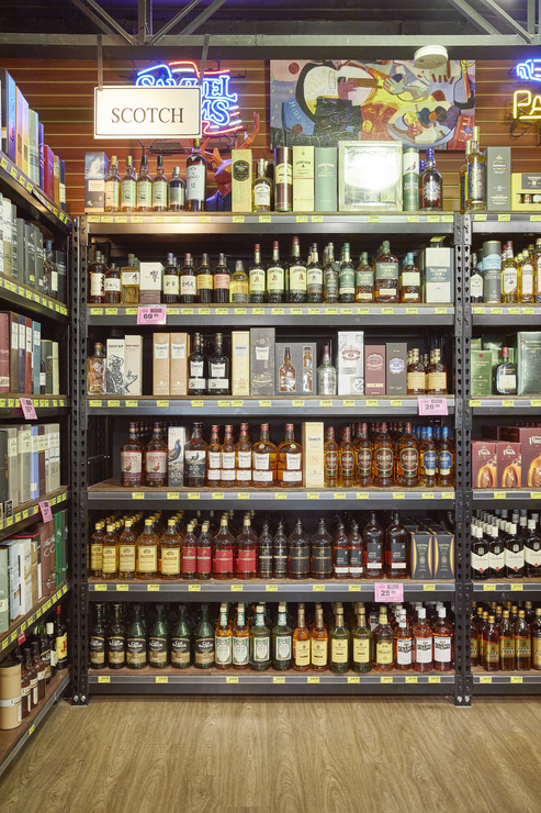 Spirits (shelvers pictured) are the driver of the Jensen's chain, accounting for 55% of annual sales.