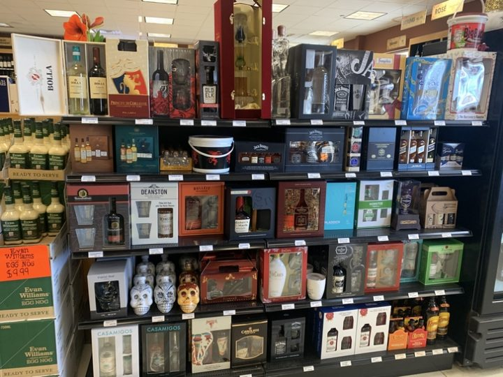 Gift sets at Fishkill Wine & Liquors in New York are showcased at the front of the store (pictured), and include offerings from Bulleit Bourbon, RumChata, and Compass Box blended Scotch.