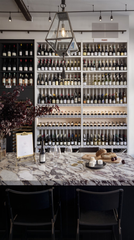 Wine comprises 90% of sales at Verve (shelves pictured), with 1,350 SKUs rang- ing from the 2018 Les Deux Moulins Loire Valley Sauvignon Blanc at $14 a 750-ml. to the 2009 Domaine de la Romanée-Conti la Tâche Grand Cru at $4,650.