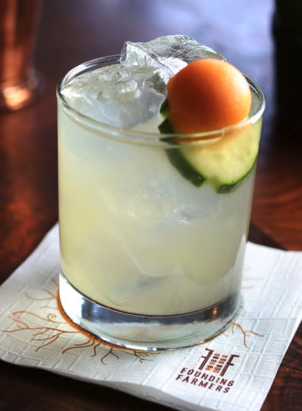 The company promotes its own spirits line—made at the single-unit Farmers & Distillers—at all of its locations in cocktails such as the Cucumber Delight (pictured).