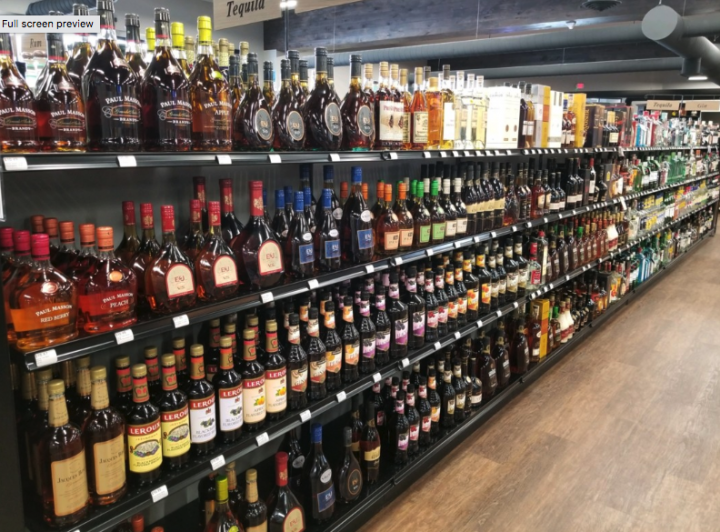 Most craft labels perform well in the on-premise, but big names like E&J still see more success at retailers such as Colorado-based Jewett's Liquor (brandy shelves pictured).