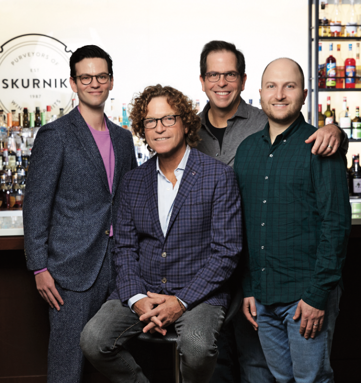 CEO Michael Skurnik (seated) founded Skurnik Wines & Spirits in 1987. His brother Harmon (second from right) joined him two years later. After 30 years in busi- ness, the brothers—along with chief sales officer Jonathan Schwartz (left) and vice president of sales operations David Skurnik, Harmon's son (right)—have made Skurnik a $145 million distributor and importer.