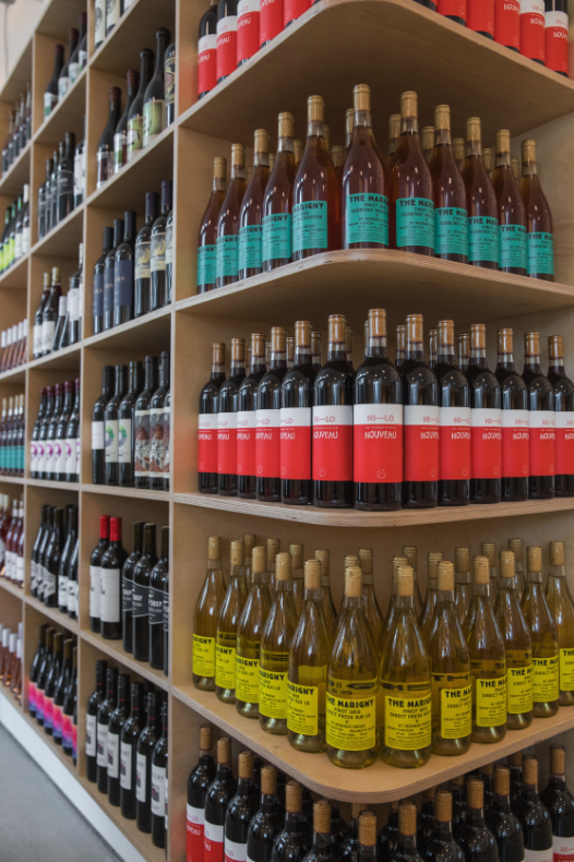 The new Hi-Lo Liquor store (wine shelves pictured) stocks 250 wine SKUs, and California wine is starting strong.