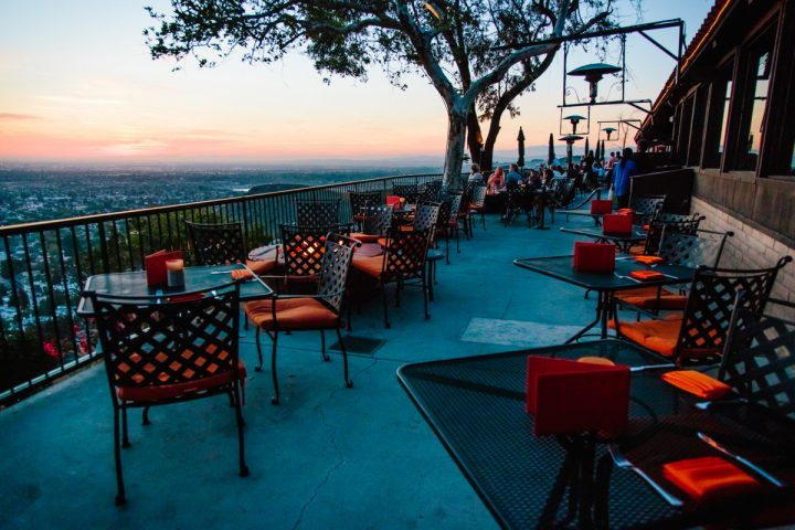 Each concept in the Specialty Restaurant Corp. portfolio features bustling bars, outdoor patios with scenic views (Orange Hill restaurant pictured).