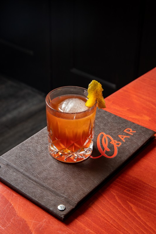 Unique drinks like the Smoke & Honey cocktail (pictured) don the menu at Specialty Restaurant Corp.'s concepts.