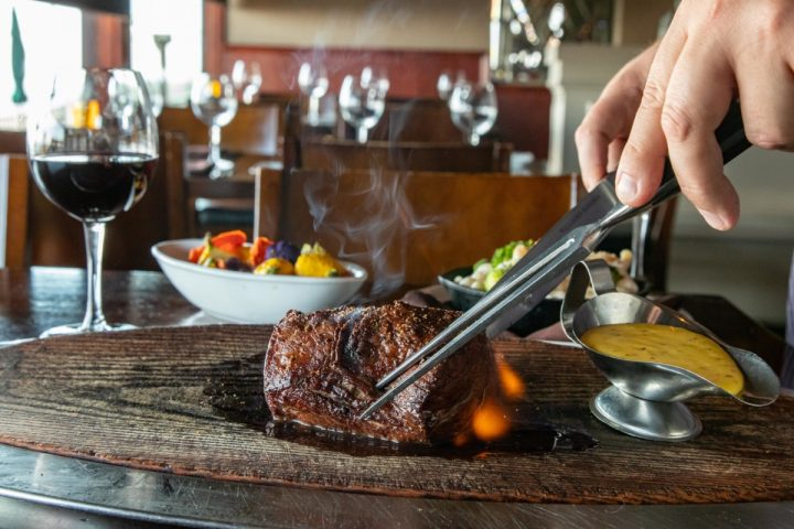 Specialty Restaurant Corp.'s myriad of venues have become known for upscale food offerings like steak and seafood (châteaubriand pictured).
