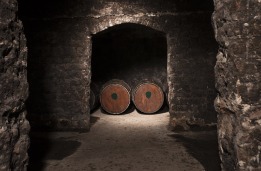 As a bonder, wine importer, and retailer, Mitchell & Son would send its empty Sherry casks to the Jameson Distillery, where they were filled with whiskey. The casks were then returned to age in the Mitchell & Son cellars (pictured) under bond.