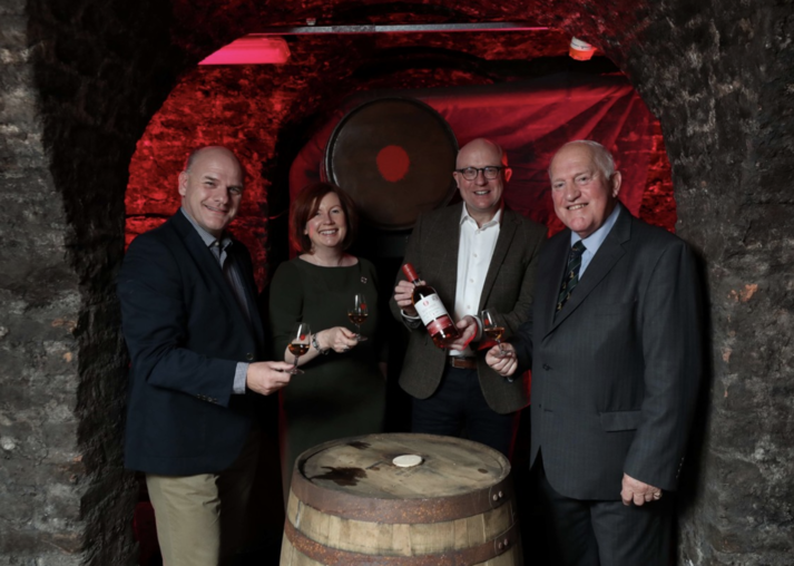 from left to right: Seventh-generation Mitchell & Son family member Robert Mitchell, Irish Distillers archivist Carol Quinn, Irish Distillers head of maturation Kevin O'Gorman, and sixth-generation leader and current Mitchell & Son managing director Jonathan Mitchell.