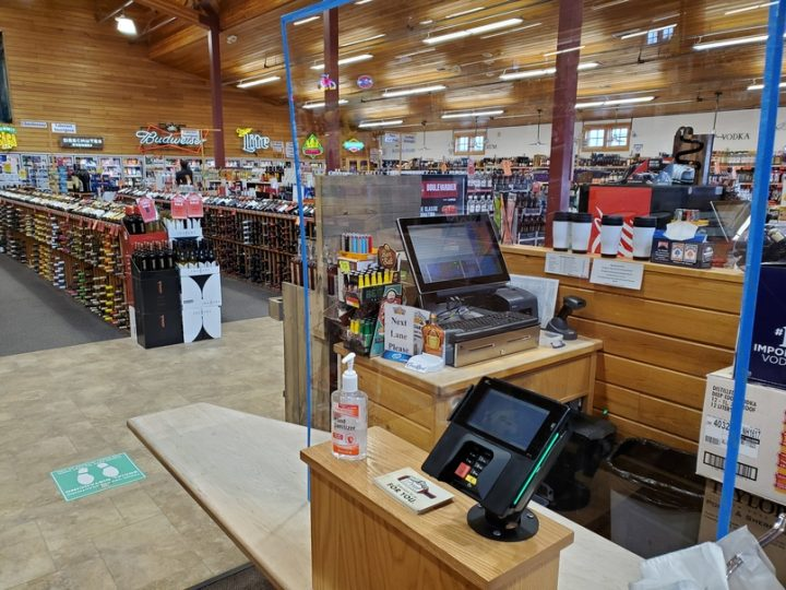 The five Happy Harry's Bottle Shops (pictured) locations in North Dakota have added Plexiglass shields at checkout counters to protect employees and customers during the Covid-19 pandemic.