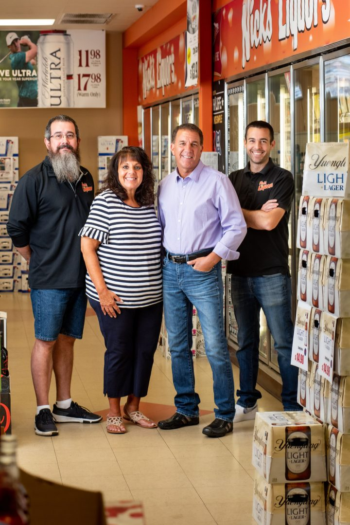 Founded in 1971 family-owned Nick's Liquors (from left: general manager Larry Jarvis, co-owners and siblings Nick and Liz Kikalos, and Nick's son, district manager Zachary Kikalos) has grown from a single store into one of suburban Chicago's major retailers.