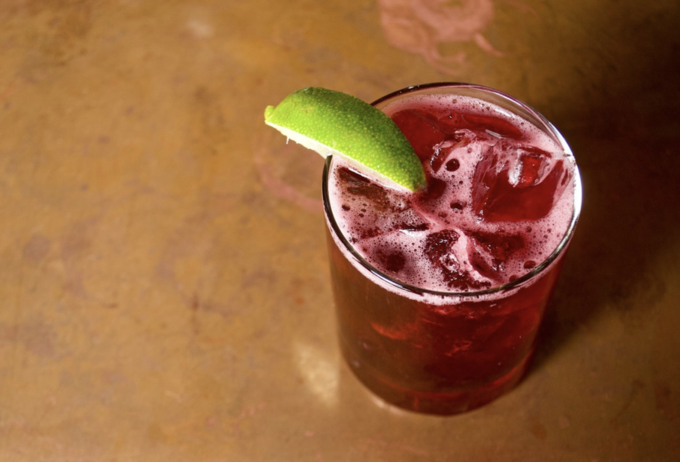 Archer & Goat's Archer cocktail (pictured) features Ilegal Joven, house-made hibiscus ginger agua fresca, simple syrup, and lime juice.
