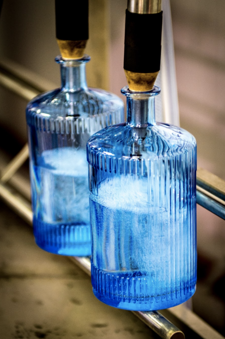 Eye-catching packaging plays a role for gin brands like Drumshanbo (bottling line pictured), whose distinct blue bottle stands out on the shelf.