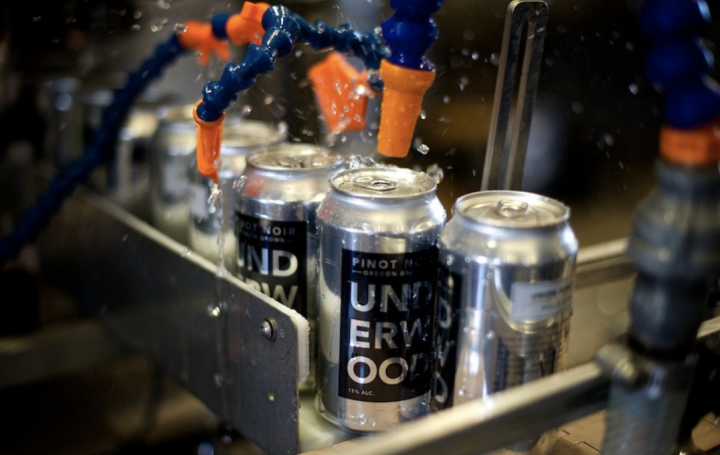 Customers are gravitating toward canned wine brands like Underwood (canning line pictured), House, and Dark Horse thanks to their convenience and portability.