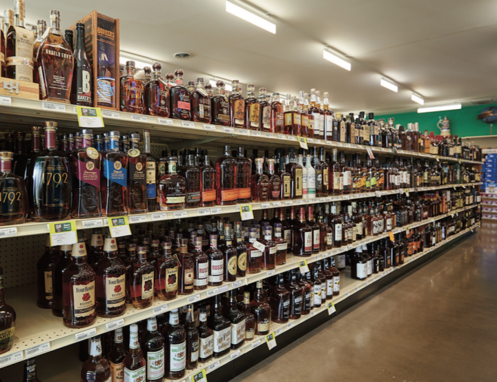 21st Amendment carries 2,200 spirits SKUs (shelves top left), with Bourbon selling particularly well. Beer accounts for 3,600 SKUs, with newer locations offering up to 25 cooler doors as well as a walk-in beer cave.