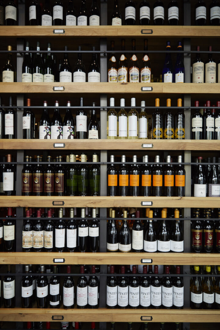 Wine (Beverly Hills wine wall pictured) makes up the vast majority of sales at Wally's at 80%. Each store stocks roughly 4,000 wine SKUs, with top-sellers including luxury labels Dom Pérignon, Opus One, and Château Mouton Rothschild.