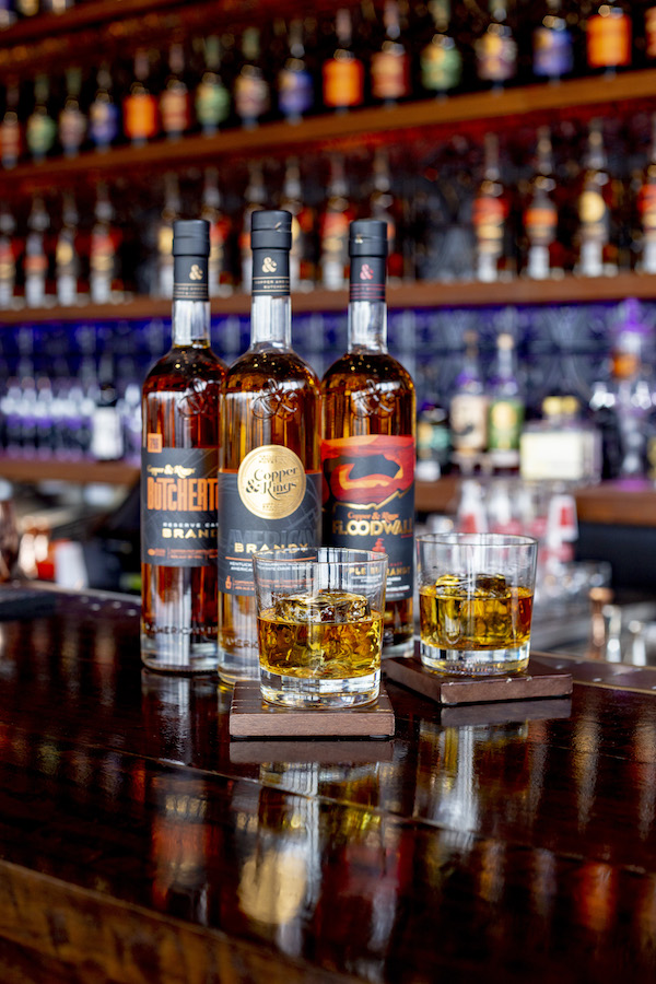 Copper & Kings' American brandy offerings (selected bottles pictured) include special releases made in partnership with other distilleries, like Chicago's F.E.W. Spirits.